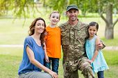 pic of reunited  - Handsome soldier reunited with family on a sunny day - JPG