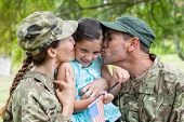 foto of reunited  - Army parents reunited with their daughter on a sunny day - JPG