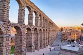 picture of aqueduct  - Ancient Roman aqueduct on Plaza del Azoguejo square in Segovia Spain - JPG