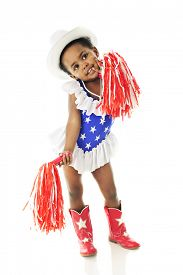 stock photo of cowgirls  - An adorable two year old in a star studded red - JPG