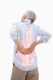 stock photo of spine  - Digital composite of Highlighted spine of man with back pain - JPG
