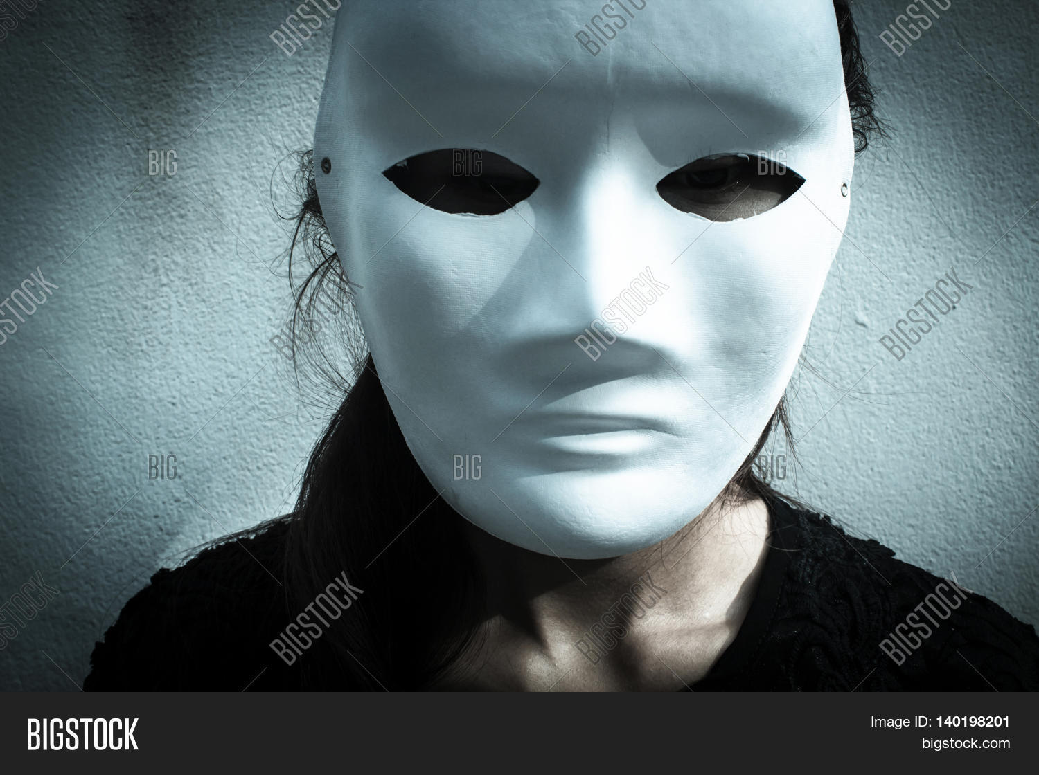 Mysterious woman in black dress wearing white mask,Scary ...