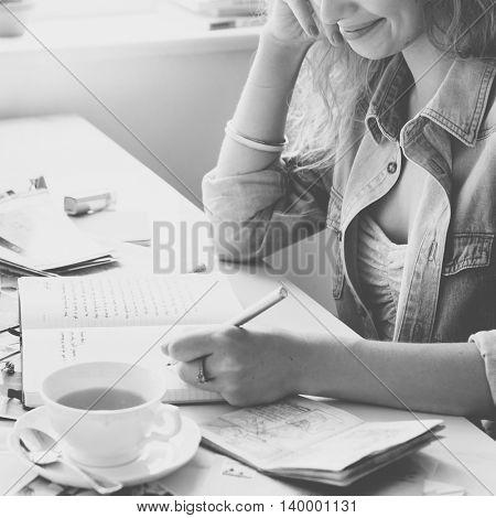Female Writing Travel Diary Memories Concept