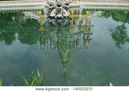 Buu Long temple reflect onto the pond in Ho Chi Minh city vietnam