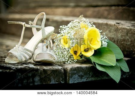 Bridal bouquet and shoes from a wedding