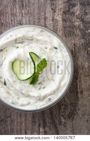 Tzatziki sauce in bowl on a rustic wooden table