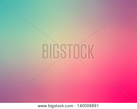 Abstract gradient pink purple teal colored blurred background.