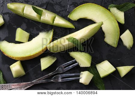 Fresh Melons Sliced And Mint On Wooden Table, Healthy Food