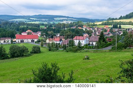 Village below the castle Velhartice - landscape showing beautiful nature and small family houses.