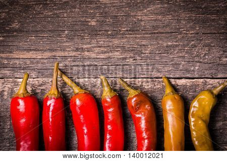 Red Chili Peppers On The Wooden Table