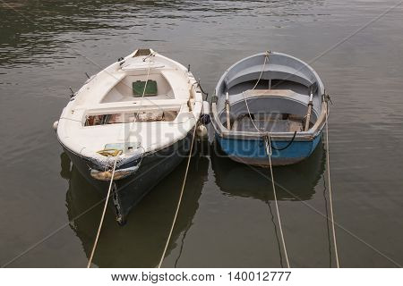 Two old wooden boat moored in a harbor