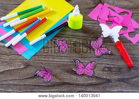 The Child Makes Decoration Paper Paper Butterfly In A Glass. Child Paints Paper Part Of The Product.