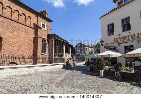 KRAKOW POLAND - JULY 05 2016 : Old synagogue in jewish district of Krakow - Kazimierz on Szeroka street. Old Synagogue is an Orthodox Jewish synagogue it is one of the oldest synagogues in Poland and one of the most valuable monuments of Jewish sacral arc