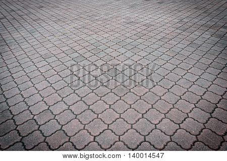 Perspective View of Monotone Gray Brick Stone on The Ground for Street Road