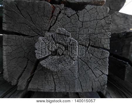 old wooden beam shaped in the center