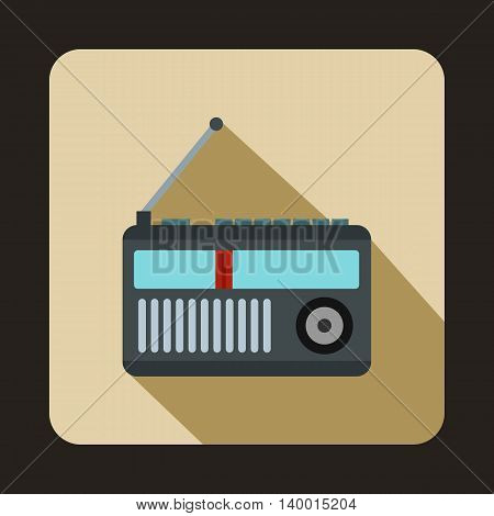 Retro radio receiver icon in flat style on a beige background