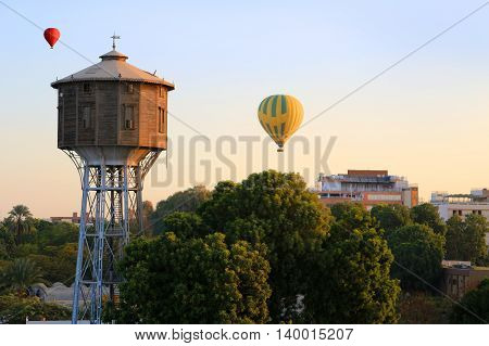 Hot Air Balloons Floating Over  Luxor At Sunrise