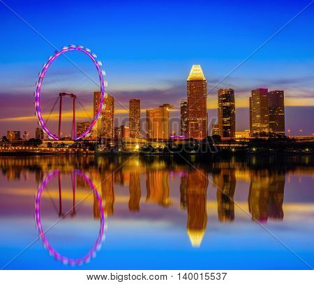 Skyline and view of skyscrapers at twilight time in Singapore.