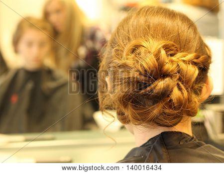 Girl having her hair done for a formal dance.