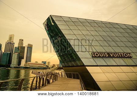 SINGAPORE- 11 JULY 2016: The futuristic building of Louis Vuitton extends out into Marina Bay in Singapore