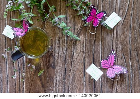 Background Decoration Paper Butterflies In A Glass Of Mint Tea. Copy Space. Children's Art Project,