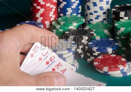 Royal flush from the diamond cards. Poker winner.