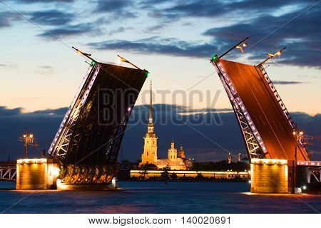 Peter and Paul Cathedral in the alignment of the diluted Palace Bridge at white night. Saint-Petersburg, Russia