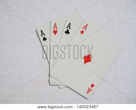 Four aces isolated on white light gray background