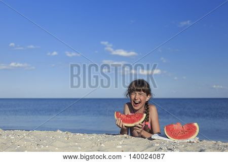 Holidays at the seaside with a delicious watermelons.