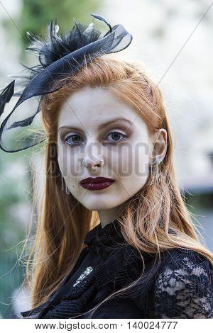 CAGLIARI, ITALY - May 29, 2016: Sunday at La Grande Jatte VIII Ed. At the Public Gardens - - portrait of a beautiful girl in Victorian costumes