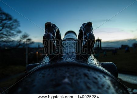 A Scottish cannon pointing at the dusk