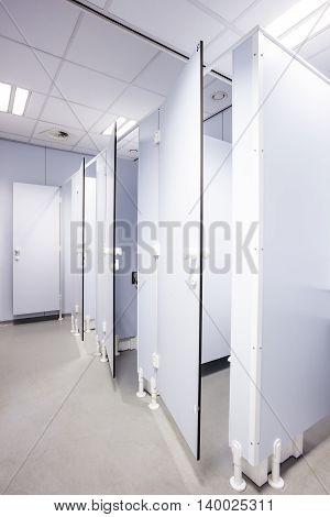 In an public building are womans toilets with black doors