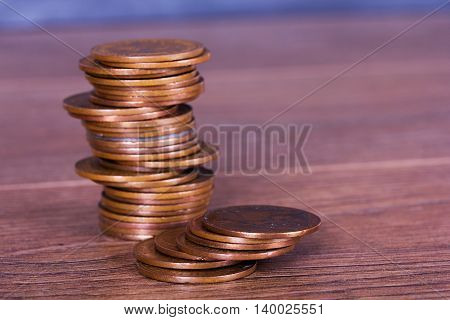 Stack Of Penny Coins On A Wooden Surface
