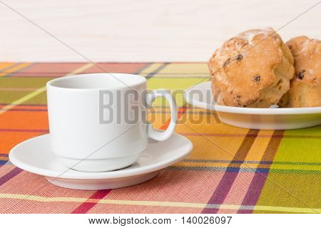 White coffee Cup cupcakes on the table