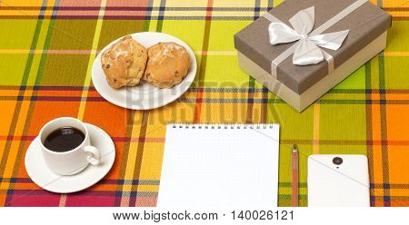 Coffee muffins smartphone gift on the table