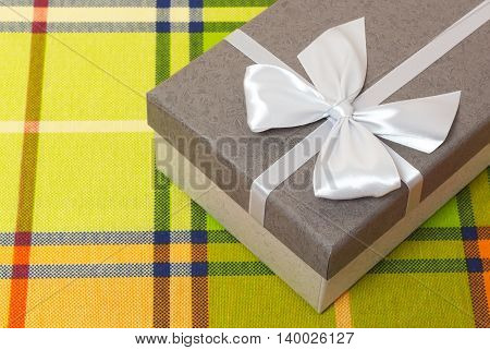 Gift box the gift on the color table