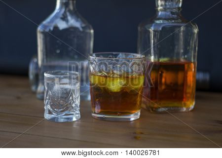 Alcoholic beverages close up on a wooden table