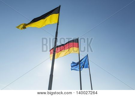 Flags of Germany and Europe at Lake Constance in Friedrichshafen harbor.