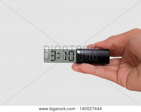 A clock in a hand isolated on white background