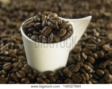 cup full of the roasted coffee bean
