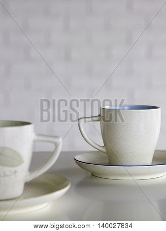 two cups of coffee with depth of field