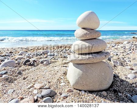 Balanced stones on the beach. Pebble beach scene.
