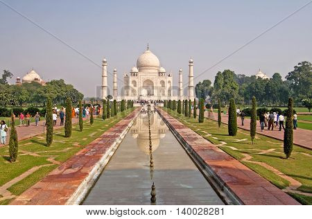 AGRA, INDIA - OCTOBER 18, 2008: Unidentified people are visiting Taj Mahal in Agra, India. The Taj Mahal is an ivory-white marble mausoleum on the south bank of the Yamuna river in the Indian city of Agra