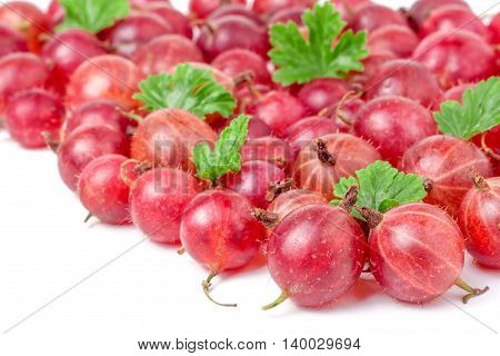 red gooseberries with leaves isolated on white background.