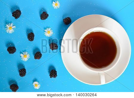 cup of tea on a blue table background and texture