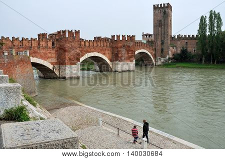 VERONA, ITALY - APRIL 26: medieval stone bridge of Scaliger Bridge on April 26, 2013 in Verona, Italy. The segmental arch bridge featured the world's largest span at the time of its construction.