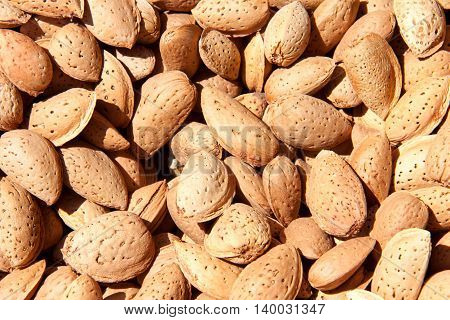 unpeeled almonds as a background close up.