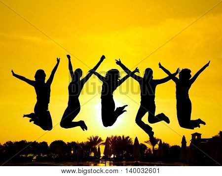 Jumping over Sunset Evening Celebration
