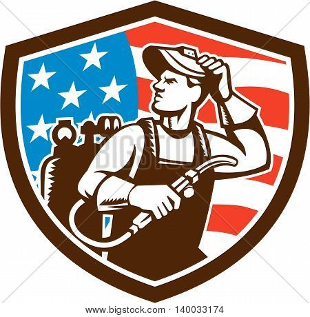 Illustration of a welder rod-holder with cable and electrode for electric arc welding and welder visor mask looking to the side with usa american stars and stripes flag in the background set inside shield crest done in retro style.