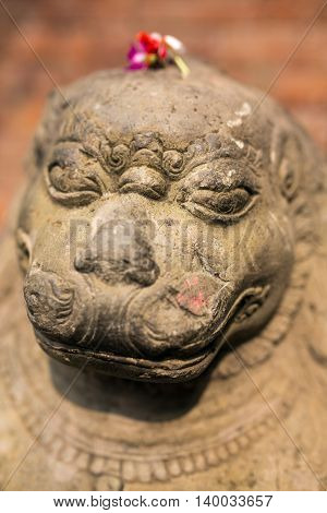Stone carving of a lion at Bhaktapur Durbar square, Nepal